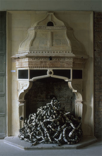 grand italian fireplace with embroiled place in it's hearth