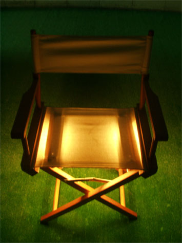 Cream directors chair- seat glowing - for audience to sit in