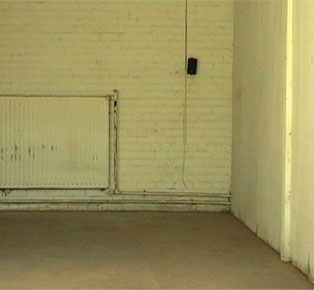 photograph of speaker no in warehouse - with radiator and painted wall