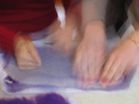 2 pairs of hands making felt