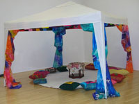 Home Made tent/gezeebo installation- featuring colourful silk drapes and cushions